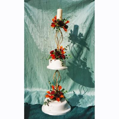 Candlestick design with Vibrant Orange Callas and Rich Burgundy Sugar Roses
