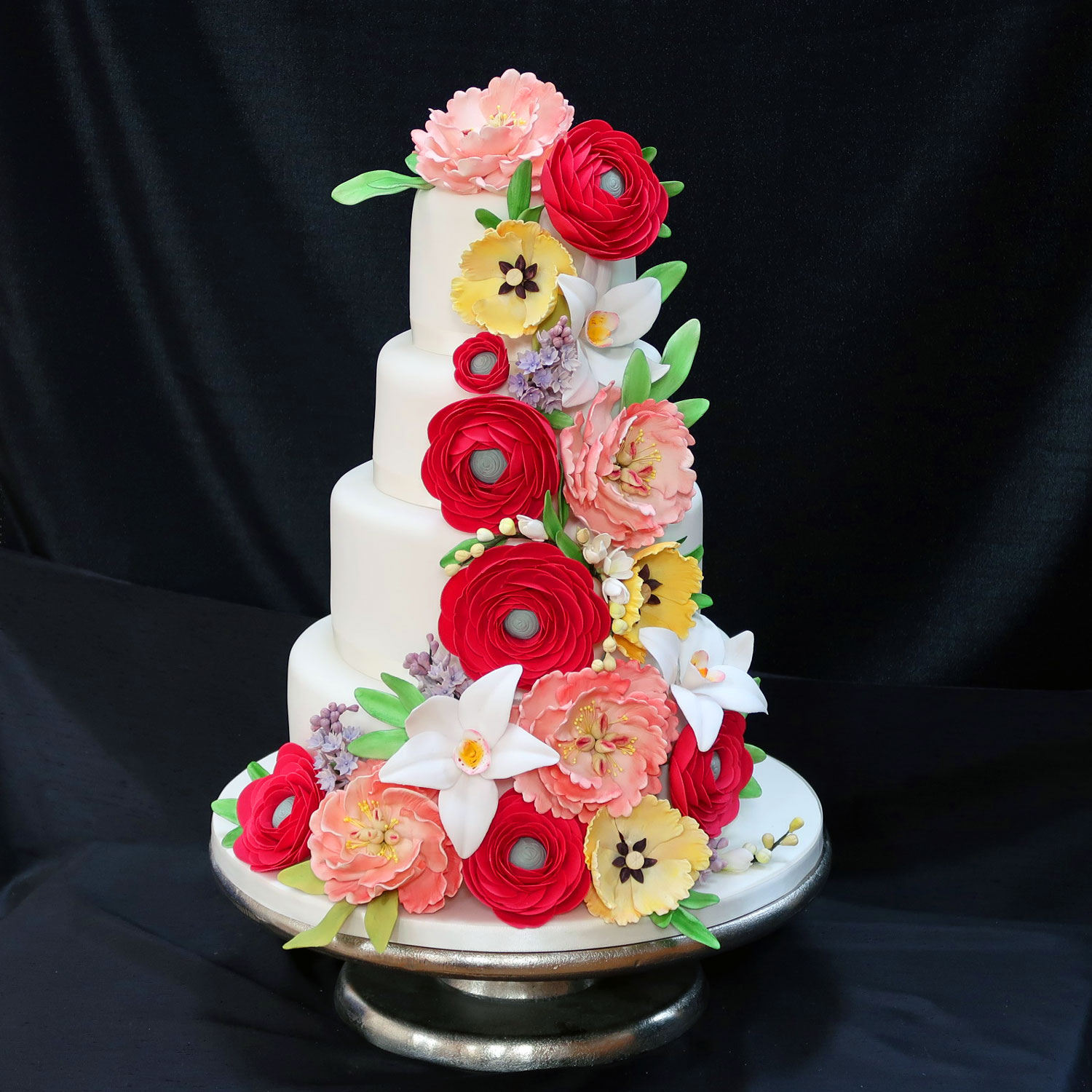 4 tier Wedding Cake with a Cascade of handcrafted sugar flowers
