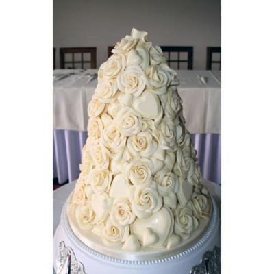 Wedding Cake Covered in Chocolate Hearts and Roses