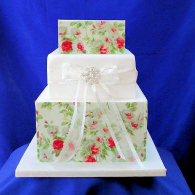 Cake covered in icing vintage rose prints.
