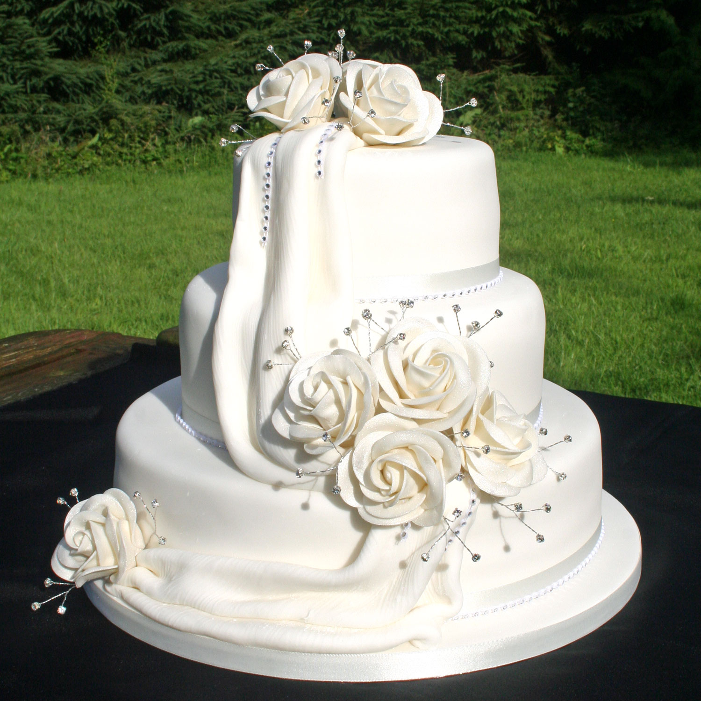 Diamante Drape Wedding Cake With Icing Drapes And Hand