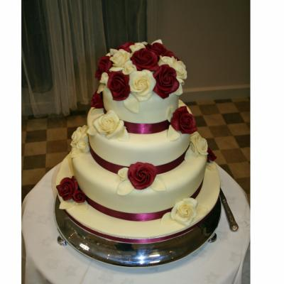 3 tier Cake decorated with Dark Red and White Chocolate Roses