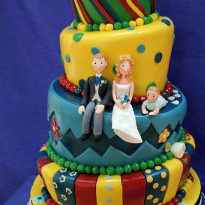 Bride, Groom and Baby on a Wonky Wedding Cake