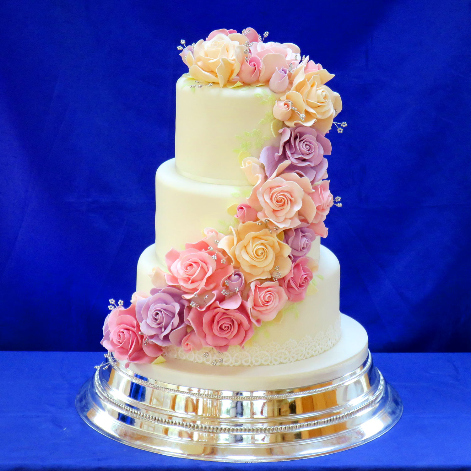 Wedding Cake decorated with hand made sugar roses.