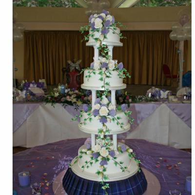 Four Tiered Wedding Cake with Tall Pillars