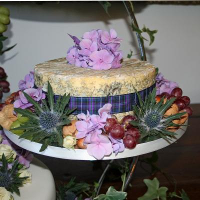 Wedding cheese decorated with fresh fruits and flowers