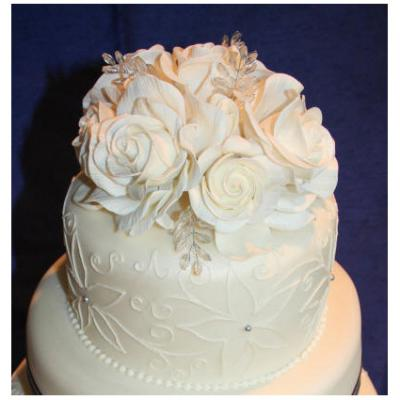 Top Tier with Sugarcraft Roses and Crystals.