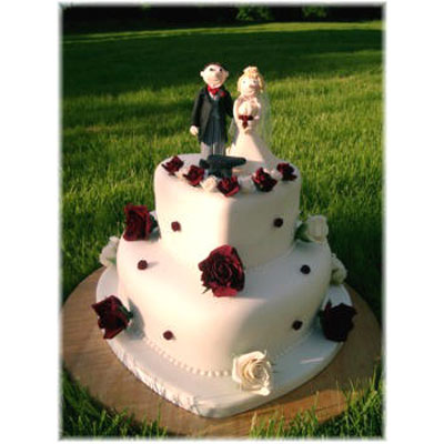 Personlaised Bride and Groom on a Heart Shaped Cake