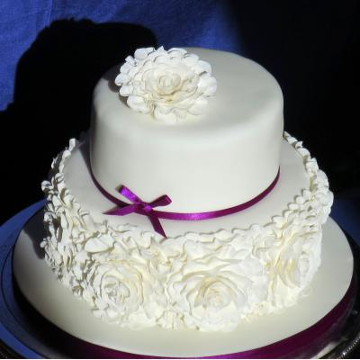 Soft icing folds create a beautiful rose inspired decoration.