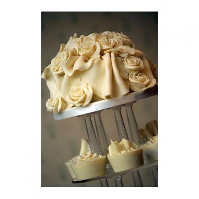 Top Tier decorated with white Chocolate Roses