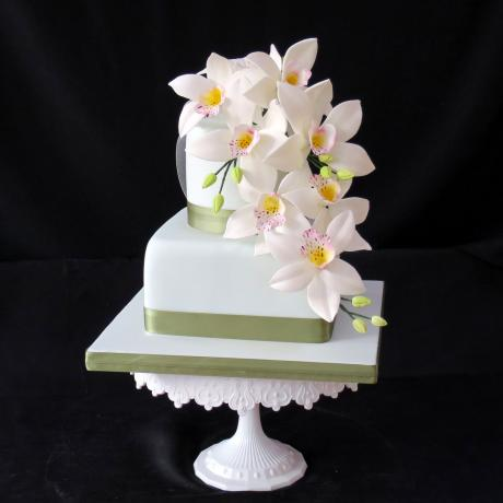 Vintage Green Iced Cake decorated with sugar orchids.
